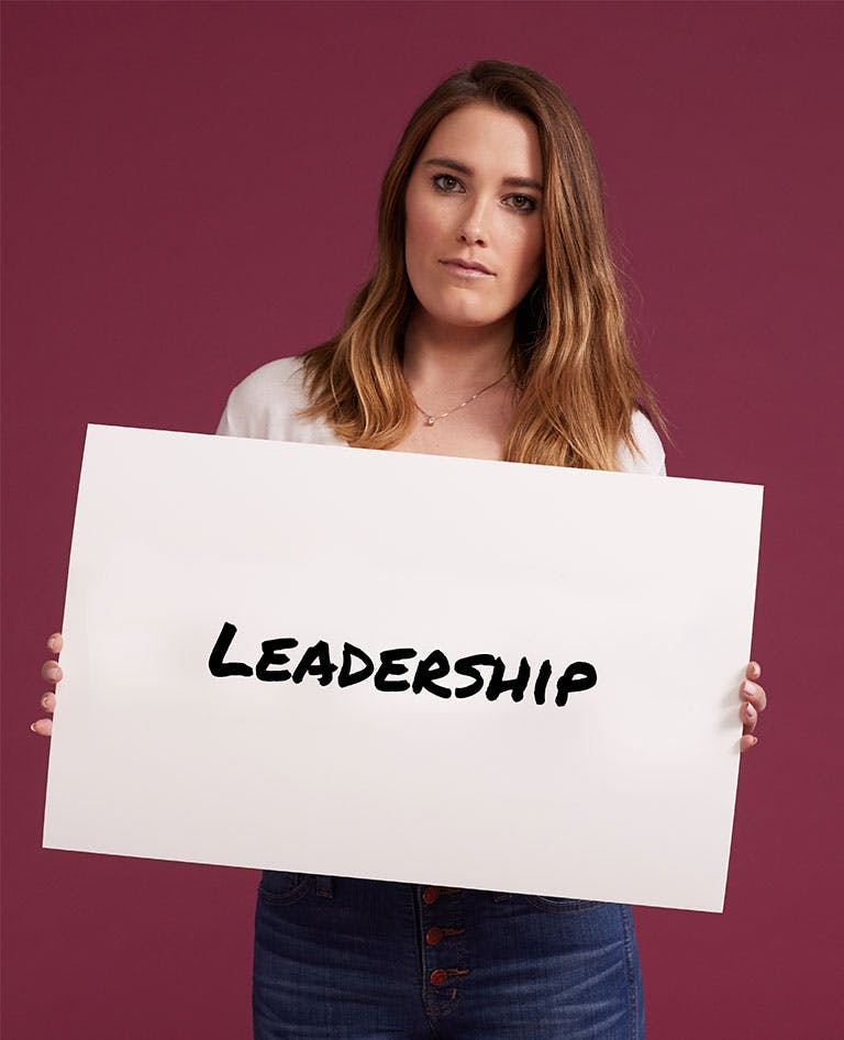Woman holding Leadership sign