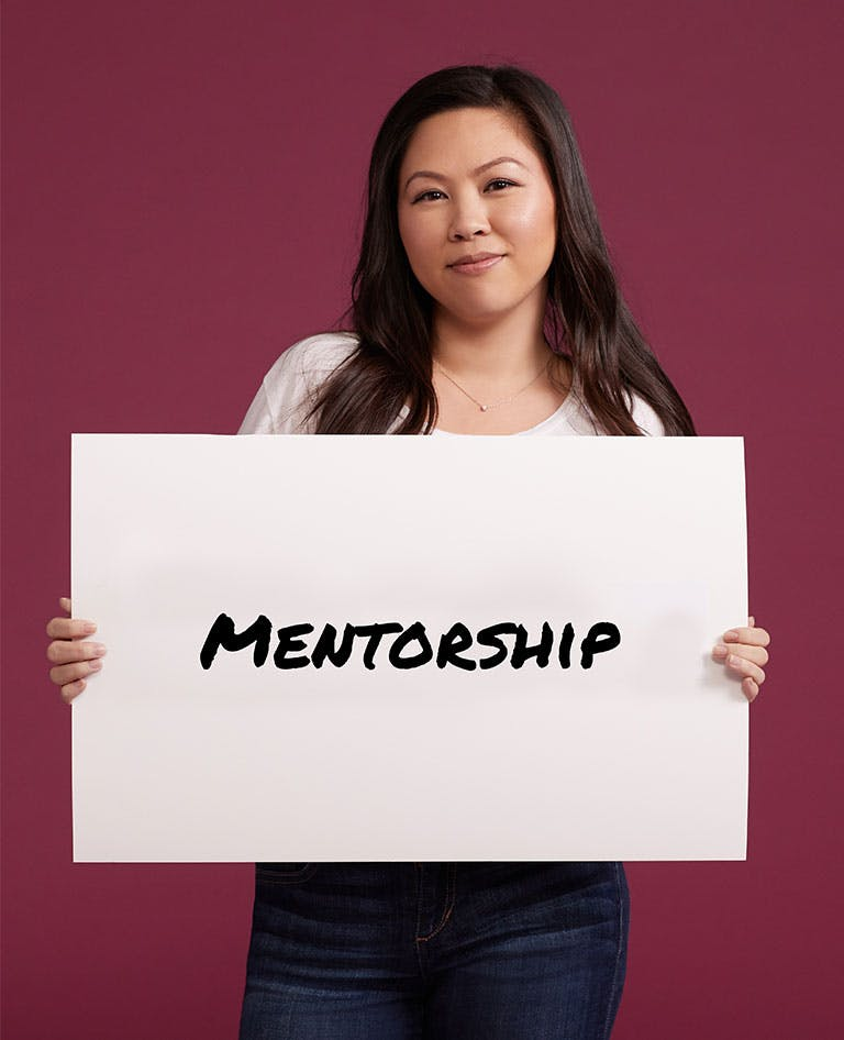 Woman holding Mentorship sign