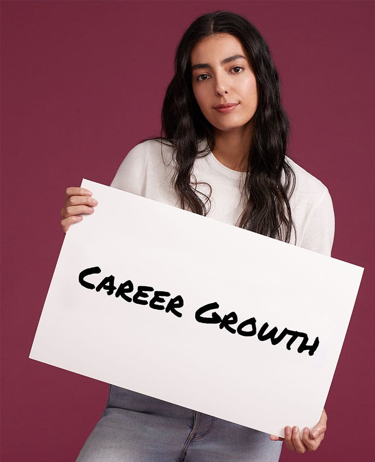 Woman holding Career Growth Sign